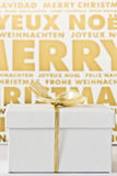 White gift box before gold and white background Royalty Free Stock Images