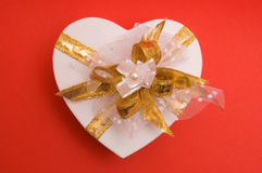 White gift box with golden bow Stock Photo