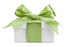 White gift box with green bow isolated Royalty Free Stock Images