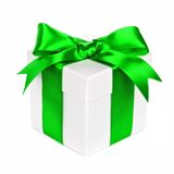 White gift box with green bow and ribbon on white Royalty Free Stock Photos