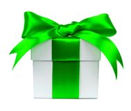 White gift box with green bow and ribbon on white Royalty Free Stock Images