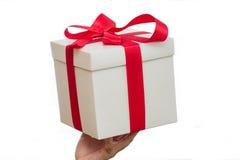 White gift box in hand Stock Photos