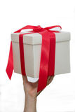 White gift box in hand Stock Images