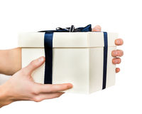 White gift box in hands of men Royalty Free Stock Photos