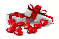 White gift box and hearts Royalty Free Stock Images