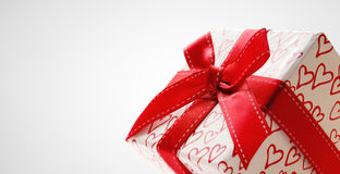 White gift box with hearts printed isolated close up Stock Photo