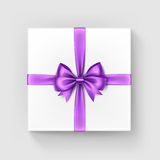 White Gift Box with Light Violet Bow and Ribbon Royalty Free Stock Photos