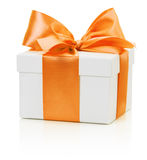 White gift box with orange bow isolated on the white background Royalty Free Stock Image