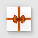 White Gift Box with Orange Satin Bow and Ribbon Royalty Free Stock Photo