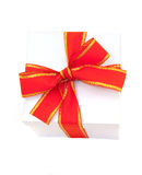 White gift box packed satin red bow Royalty Free Stock Photo
