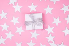 White gift box on pink background stock images