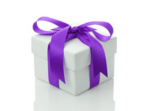 White gift box with purple ribbon bow Royalty Free Stock Photo