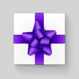 White Gift Box with Purple Violet Ribbon Bow Royalty Free Stock Photography