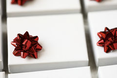 White Gift Box with Red Bow Royalty Free Stock Image