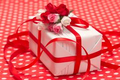 White gift box with red bow and paper flowers Royalty Free Stock Photo