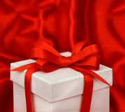 White gift box with red bow ribbon Stock Image