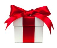 White gift box with red bow and ribbon over white Stock Photography