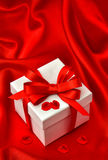 White gift box red bow ribbon roses flower petals Royalty Free Stock Image