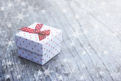 White gift box with red dots Stock Images