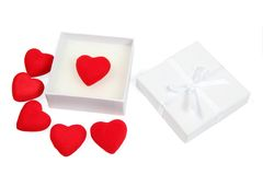 White gift box with red hearts Royalty Free Stock Photos