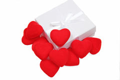 White gift box with red hearts Stock Photos