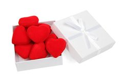 White gift box with red hearts Stock Photo