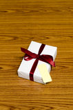 White gift box and red ribbin with tag Royalty Free Stock Images