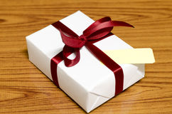 White gift box and red ribbin with tag Stock Images