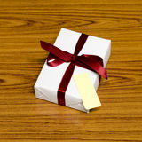 White gift box and red ribbin with tag Royalty Free Stock Image