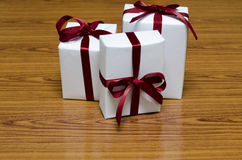 White gift box with red ribbin Stock Image