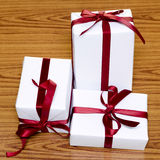 White gift box with red ribbin Stock Photography