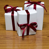 White gift box with red ribbin Royalty Free Stock Images