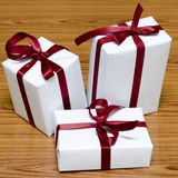 White gift box with red ribbin Royalty Free Stock Photo