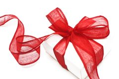 The white gift box with the red ribbon Royalty Free Stock Photo