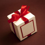 White Gift Box and Red Ribbon Stock Image