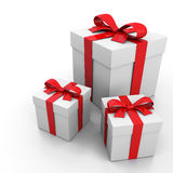 White gift box and red ribbon Stock Photos