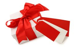 White gift box with red ribbon Stock Photos