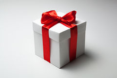 White gift box with red ribbon Stock Photo