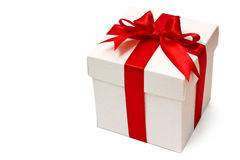 White gift box with a red ribbon and bow Stock Photo