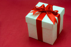 White gift box with a red ribbon and bow Stock Images