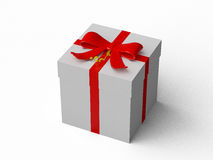 White gift box with red ribbon bow Royalty Free Stock Photos