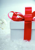 White gift box with red ribbon and bow Royalty Free Stock Photos