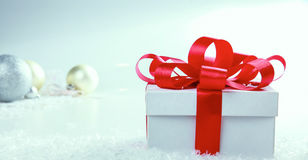 White gift box with red ribbon and bow Stock Images