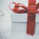 White gift box with red ribbon and bow Royalty Free Stock Photography