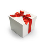 White gift box with red ribbon bow royalty free stock photo
