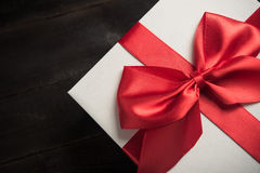 White gift box with red ribbon Royalty Free Stock Photography