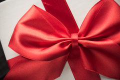 White gift box with red ribbon Royalty Free Stock Image