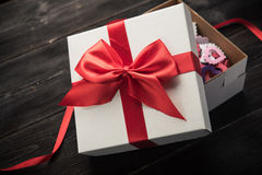 White gift box with red ribbon Stock Image
