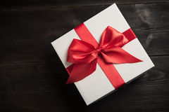 White gift box with red ribbon Royalty Free Stock Photo