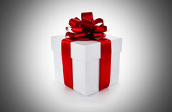 White gift box with red ribbon and bow Stock Photography